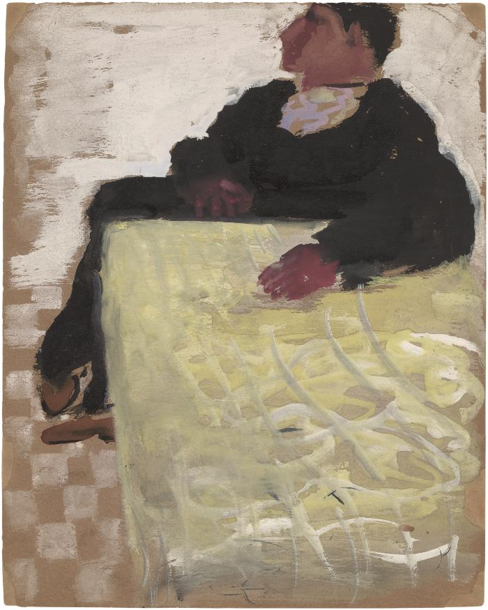 [Seated man at table]
