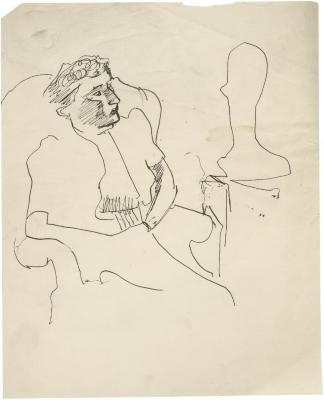 [Woman in armchair with sculpture]