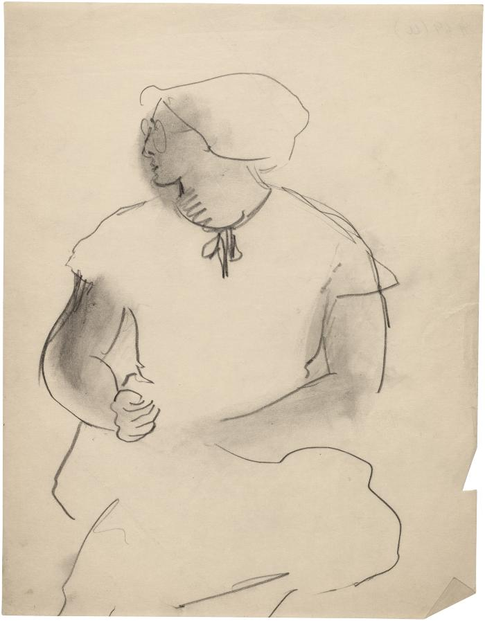 [Seated woman with eyeglasses]
